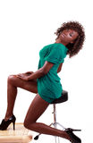Young black woman sitting in green dress Royalty Free Stock Photos