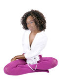 Young black woman sitting in purple tights Stock Photography