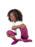 Young black woman sitting in purple tights Stock Photo