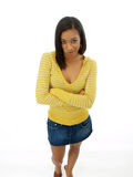 Young black woman with skeptical expression. Young black woman in yellow top and jean skirt Royalty Free Stock Images
