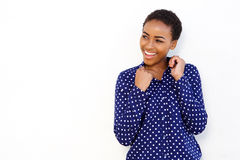 Young black woman smiling against isolated white background Stock Photo