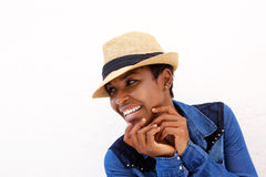 Young black woman smiling against white background with hat Royalty Free Stock Photos