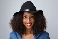 Young black woman smiling with hat Stock Image