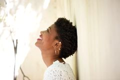 Young black woman smiling and looking up Royalty Free Stock Images