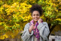Young black woman smiling outdoors in autumn Stock Image