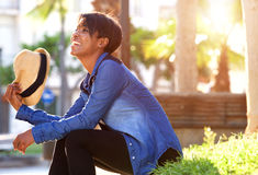 Young black woman smiling outside in park Royalty Free Stock Images