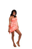 Young black woman standing in dress smiling Stock Images