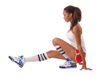 Young black woman stretching out in shorts. Young black woman in red shorts stretching out Royalty Free Stock Photos