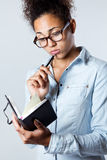 Young black woman taking notes at home Stock Photography