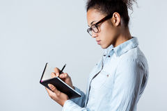 Young black woman taking notes at home Royalty Free Stock Photo
