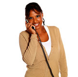 Young black woman talking on phone looking at you Stock Image