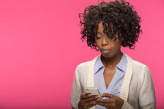 Young black woman texting cell phone Royalty Free Stock Image