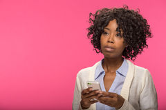 Young black woman texting cell phone Stock Photography