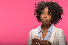 Young black woman texting cell phone Royalty Free Stock Images
