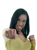 Young black woman throwing a punch. Young black woman with fists clinched throwing a punch Royalty Free Stock Image