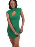 Young black woman unsnapping her green dress. Young woman seductively opening her knit dress Royalty Free Stock Photos
