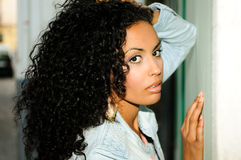 Young black woman in urban background Stock Image