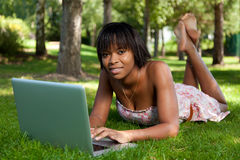 Young black woman using a laptop Royalty Free Stock Image
