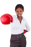 Young black woman wearing boxing gloves. Young African American woman wearing boxing gloves stock image