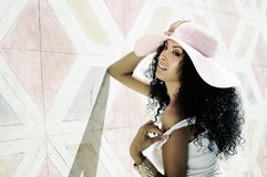 Young black woman wearing dress and sun hat, afro hairstyle. Portrait of a young black woman, model of fashion wearing dress and sun hat, with afro hairstyle in Stock Image
