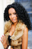 Young Black Woman Wearing Fur Vest Stock Images