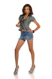 Young Black woman wearing a mini skirt Stock Photography