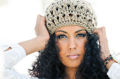 Young black woman wearing a wool cap. Portrait of a young black woman wearing a wool cap Royalty Free Stock Photo