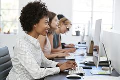 Young black woman working at computer in office with headset Stock Image