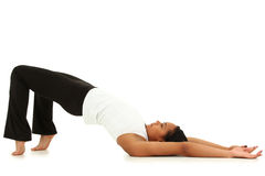 Young Black Woman Yoga Over White Background royalty free stock photography