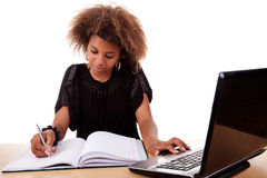 Young black women working on desk with computer royalty free stock photo