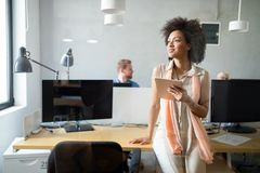 Young african american woman working with tablet in office stock image