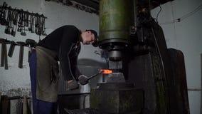 Blacksmith Forging Hot Metal Using Forging Press