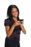 Young Blacl woman text messanging Stock Image