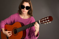 Young blind woman playing guitar Royalty Free Stock Photos