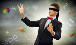Young blindfolded man Stock Images
