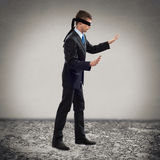 Young blindfolded man Stock Photography