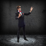 Young blindfolded man Stock Image