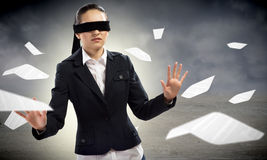 Young blindfolded woman Royalty Free Stock Image