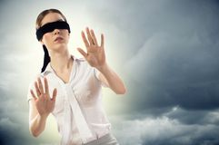 Young blindfolded woman Stock Images