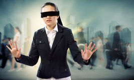 Young blindfolded woman Royalty Free Stock Photos