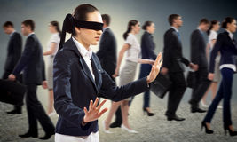 Young blindfolded woman stock image