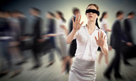 Young blindfolded woman stock photos