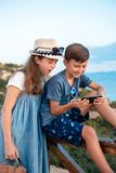 Young bloggers on the beach royalty free stock photography