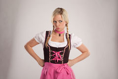 Young blond angry woman with dirndl costume Royalty Free Stock Photos