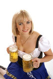 A young blond bavarian woman holding beer Stock Photography