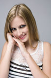 Young blond beauty with mischievious smile. Stock Photos
