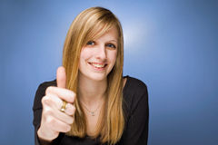 Young blond beauty showing thumbs up. Royalty Free Stock Photos