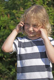 Young blond boy is calling Stock Photography