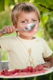 Young blond boy has healthy eating habits Royalty Free Stock Photo