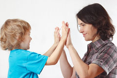 Young blond boy playing with his mother royalty free stock photo